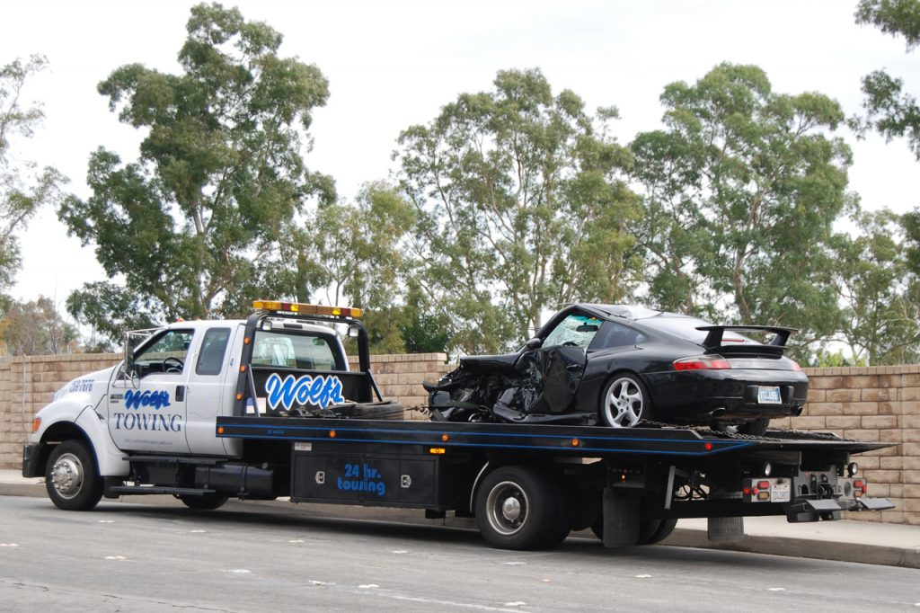 Flatbed Tow Truck Towing A Black Car