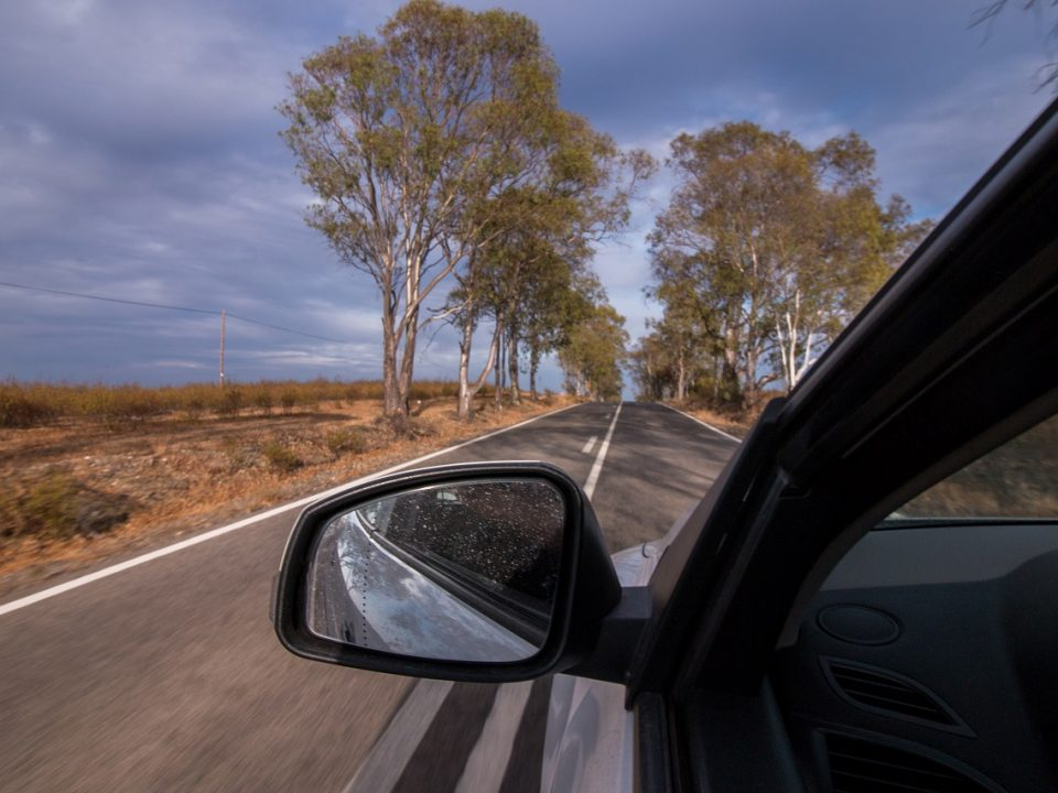 driving for long distances on a road with a countryside view